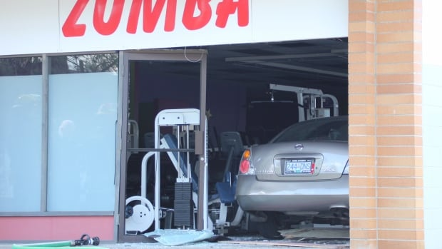 The Surrey fire department received the call for a vehicle that had been driven into the gym at 12:34 p.m. PT Monday.