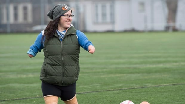 Lindsay Hilton, who was born without full arms and legs, coaches rugby at Dalhousie University in Halifax. Earlier this month Hilton allowed her gym, CrossFit OnSide, to send out a video of her working out on Facebook and within a few hours it had six million views.