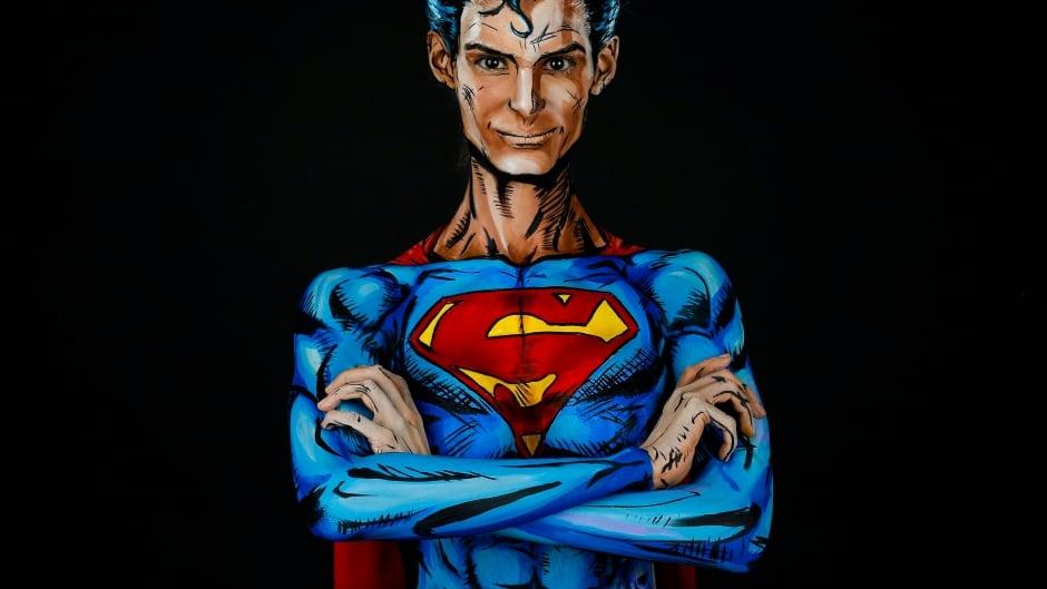 It S Magic Calgary Artist Uses Paint To Transform Into Man Of Steel Cbc News