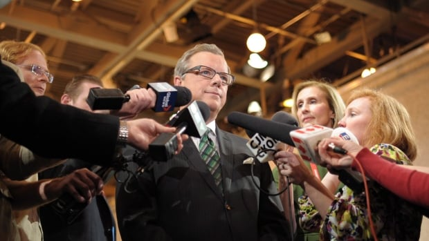 Saskatchewan Party Leader Brad Wall speaks with reporters after last week's leaders' debate with NDP Leader Cam Broten.