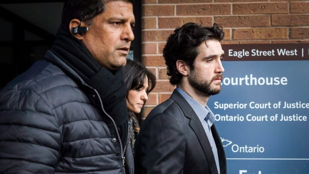 Marco Muzzo, right, leaves the Newmarket, Ont., courthouse surrounded by family in February. Muzzo was sentenced to 10 years in prison for the Vaughan, Ont., collision that killed four people.