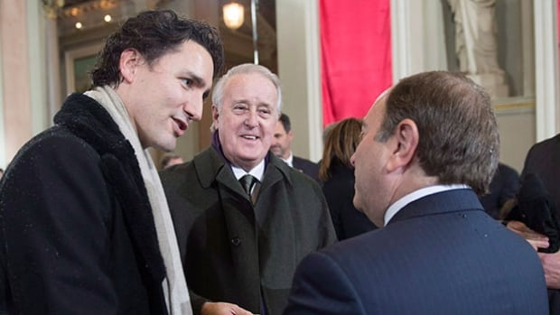 Prime Minister Justin Trudeau, seen here in a 2014 file photo with NHL commissioner Gary Bettman, right, and former Prime Minister Brian Mulroney, centre, was asked Tuesday for his thoughts on the ongoing concussion debate in the NHL.