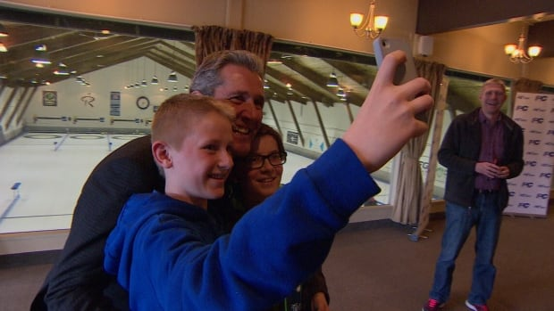 PC Leader Brian Pallister, shown here taking a selfie with some young curling fans at Rossmere Curling Club, promised to build an international curling centre of excellence in Winnipeg if his party forms government April 19.