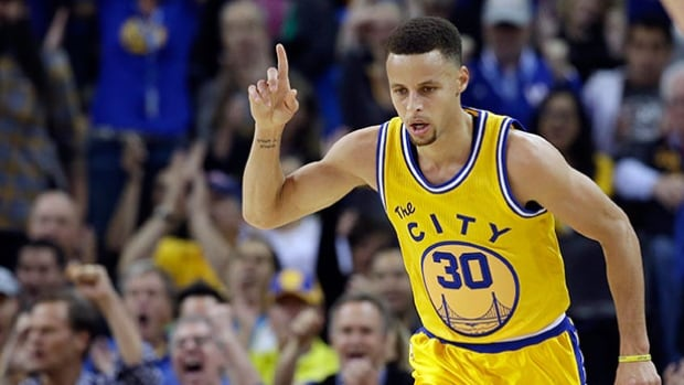 Golden State Warriors' Stephen Curry celebrates after scoring against the Washington Wizards Tuesday in Oakland, Calif.