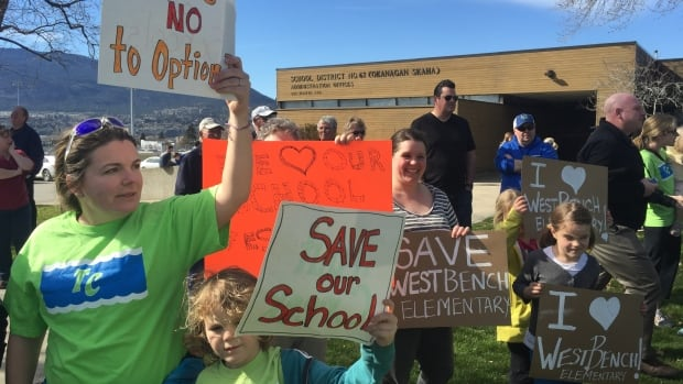 Parents and students protest outside the School District 67 office on Tuesday.