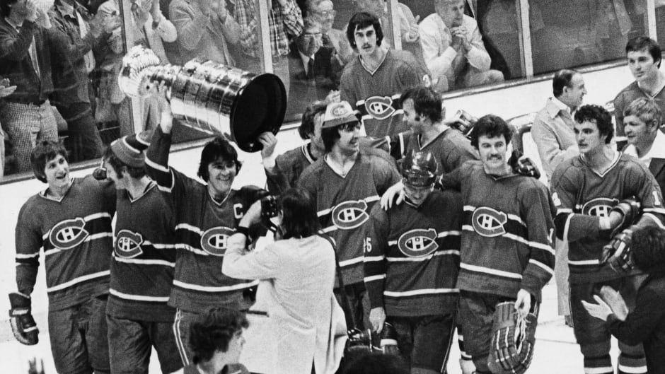 Team captain Serge Savard  (holding trophy) leads the  Montreal Canadiens after their 1977 Stanley Cup win in Boston,  May 14, 1977.