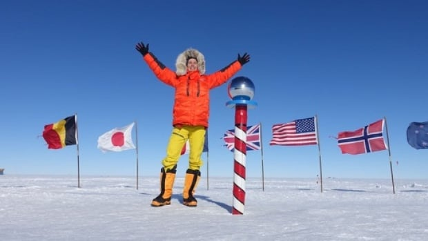 Professional triathlete Colin O'Brady stands at the South Pole as part of his world record attempt to be the fastest person to complete the Explorer's Grand Slam.