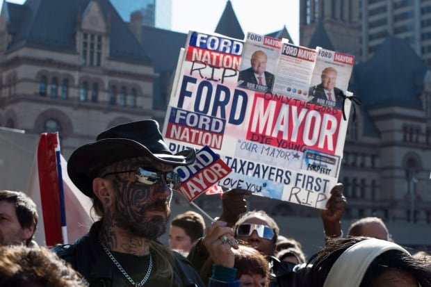 Ford mourners wait with RIP sign