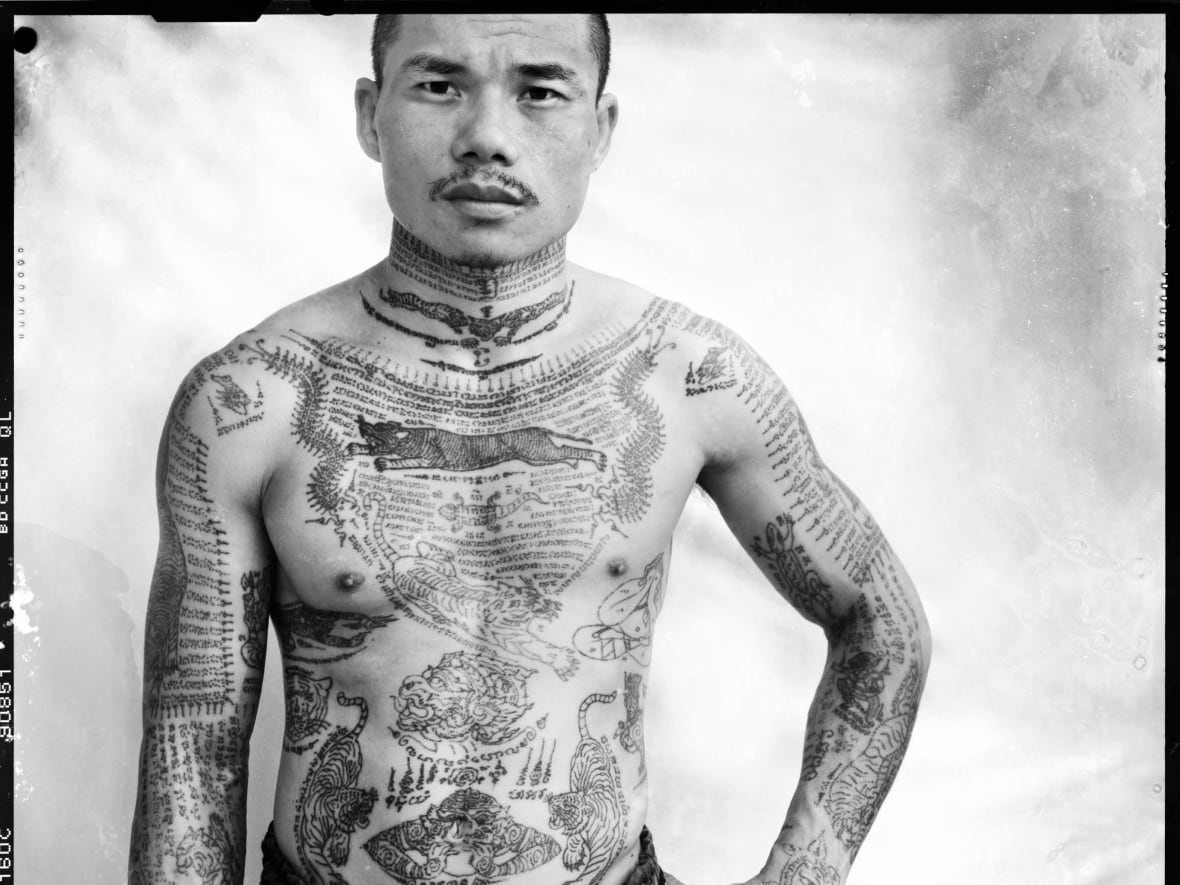 3e72cfb755bb0 The latest exhibition to open at the ROM, in Toronto, delves deep into the  world of tattoos. The show features portraits by Bangkok-based photographer  ...