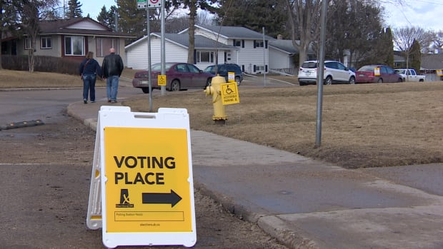 People voting in the spring 2016 provincial election leave their voting station.