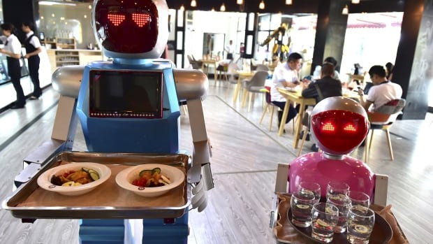 Automation in restaurants like this one in China is springing up around the world. Service industry entry level jobs are at risk of being replaced or reduced because of technological trends.
