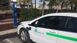 Electric car charging at a station in Quebec's Circuit Electrique