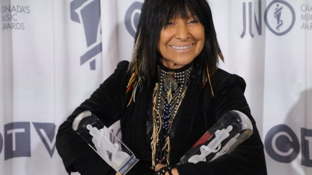 Buffy Sainte-Marie with her two Junos, one for Aboriginal Album of the Year and another for Contemporary Roots Album of the Year. It was a big night for her as well as the Weeknd, Dear Rouge and the band Whitehorse.