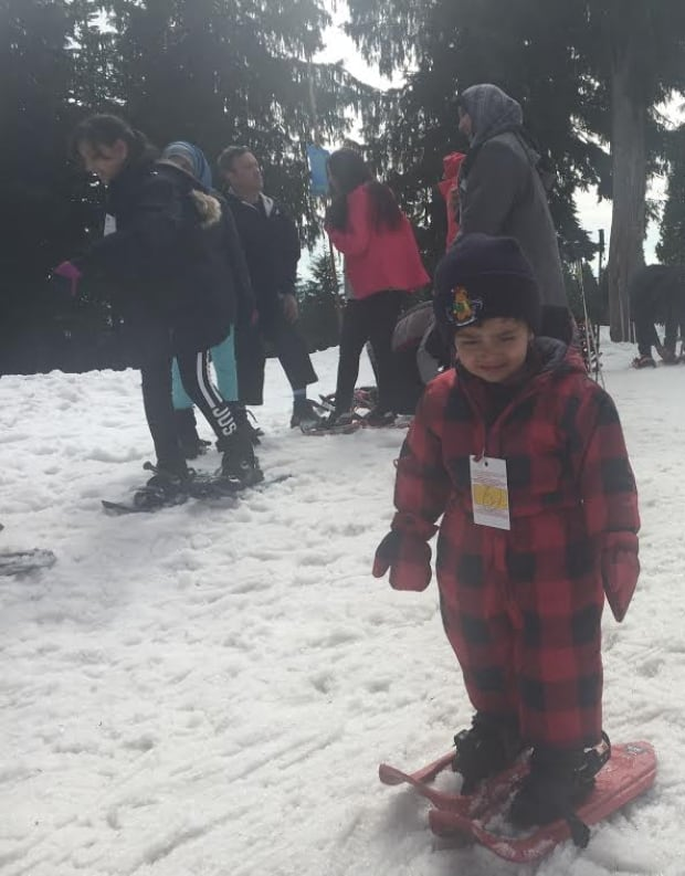 Young Syrian boy on snow shoes