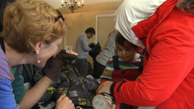 Syrian refugees on mount seymour, free gear