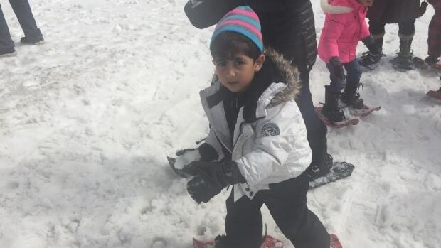Mohammad was one of 350 refugees invited to Mt. Seymour for a fun event, which for many was the first time they had ever seen or felt snow.