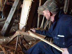 Russell Ives works on snowshoes