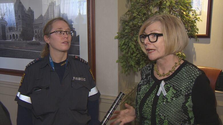 Councillor Cheri DiNovo, paramedic Shannon Bertrand