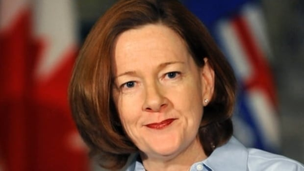 Former premier Alison Redford has been cleared in a re-investigation of allegations she interfered in the choice of a legal consortium to represent Alberta in a multi-billion-dollar lawsuit against the tobacco industry.