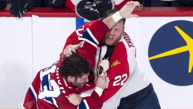 The Montreal Canadiens' Mike Brown and Florida Panthers' Shawn Thornton square off during a March game in Montreal. Thornton used to scan the roster of his team's next opponent for players he might have to fight, but in today's NHL that's no longer necessary. It's a new reality embraced by the 38-year-old one-time enforcer.