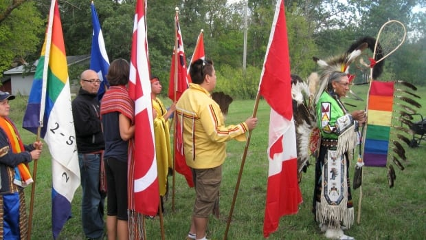 A powwow is held at the 22nd annual International Two-Spirit Gathering in Manitoba in 2010. Elder Wilfred Abigosis holds the Two-Spirit Eagle Staff.
