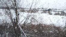 train window rain snow drops winter