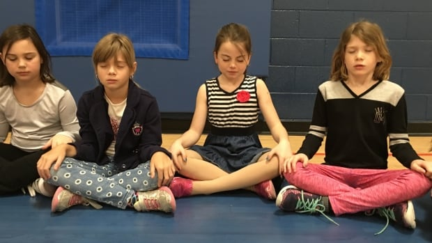 Students say meditation club helps them calm down when they are overwhelmed by the things they have to do at school.