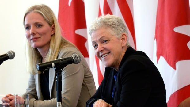 U.S. Environmental Protection Agency (EPA) Administrator Gina McCarthy (right) speaks to reporters as Minister of Environment and Climate Change Catherine McKenna looks on, April 7, 2016 in Ottawa.