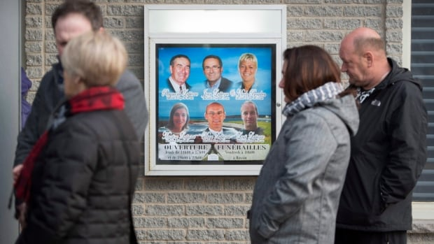 People line up at the funeral home in Cap-aux-Meules, Que., on Thursday, April 7, 2016.