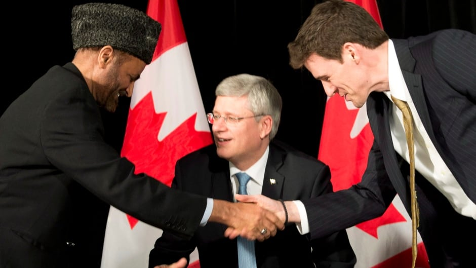 closing s controversial office of religious dom  prime minister stephen harper looks on as dr andrew bennett right shakes