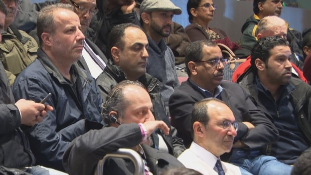 Taxi drivers and plate owners watched as the city committee approved changes to the city's bylaws to allow for companies like Uber to operate legally.