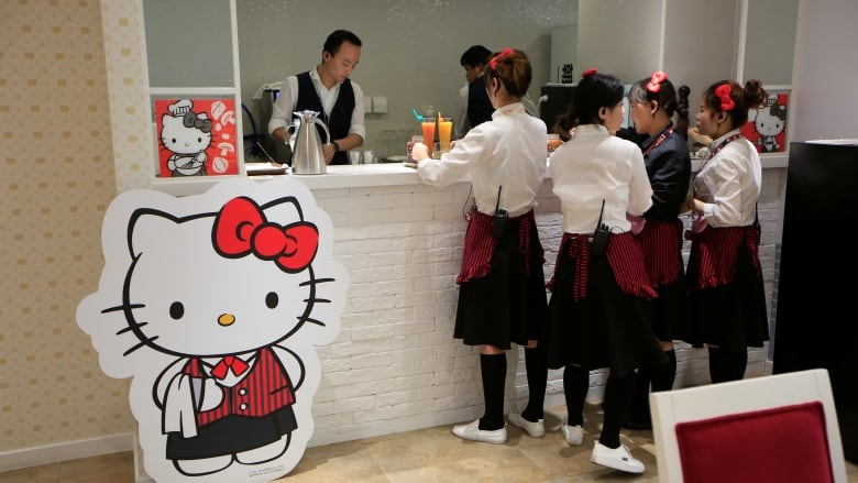 7ebb6c3ff Employees prepare food for customers in China's first official Hello Kitty-themed  restaurant in Shanghai, China. (Aly Song/Reuters)