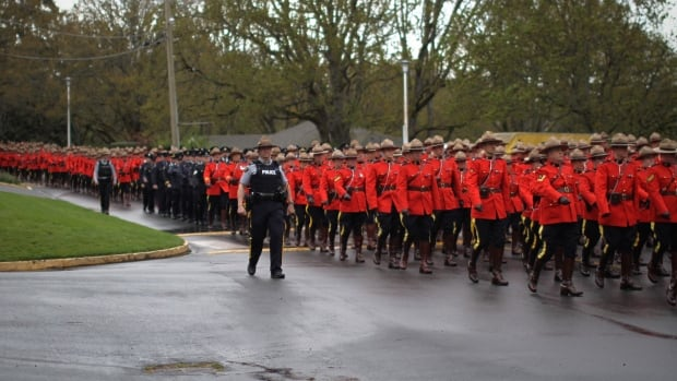 Mounties march in a solemn procession before the RCMP regimental funeral for Const. Sarah Beckett in Colwood on Tuesday.