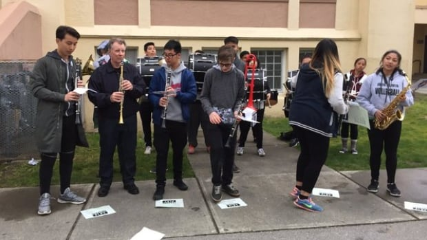 Students and teachers perform as part of a rally against the VSB's proposed cuts to band and string programs in Vancouver.
