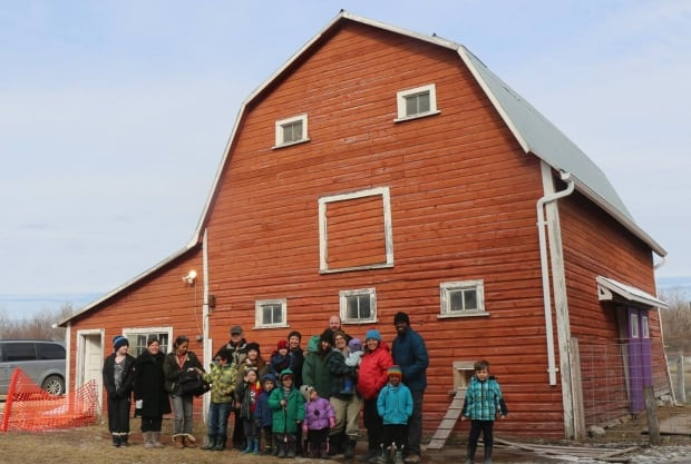 Barn shot, families supporting Michelle McHale