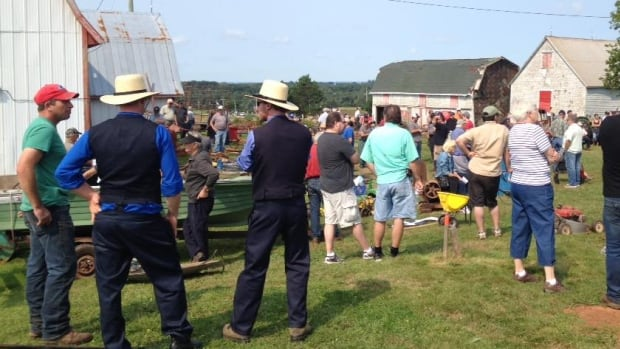 A couple of Amish men attended a farm auction in Stratford, P.E.I. in summer 2015.