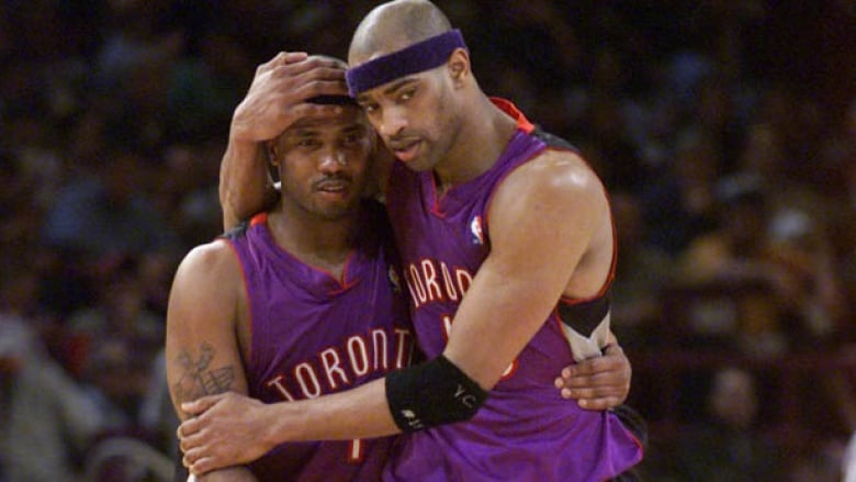 aee684fa60d Vince Carter, right, embraces Chris Childs as the Toronto Raptors won their  first ever playoff series against the New York Knicks in 2001.