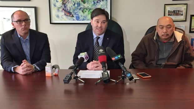 NDP health critic and Vancouver Kingsway MP Don Davies (centre) has launched a parliamentary study into a national prescription drug plan.