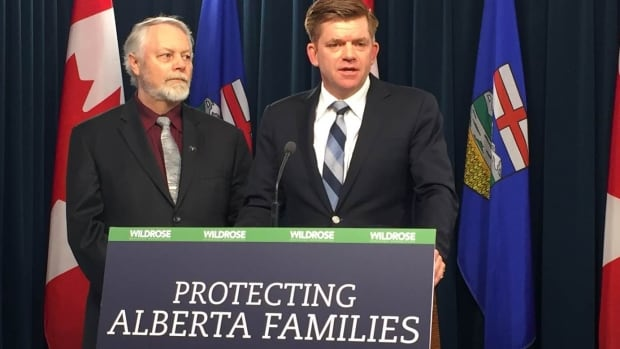 Wildrose Leader Brian Jean (right) wants the NDP government to study the full economic effects of the carbon tax before implementing it next year. Jean appeared at the Monday news conference with Wildrose electricity and renewable energy critic Don McIntyre.