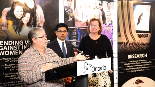 Sylvia Maracle, (left), the executive director of the Ontario Federation of Indigenous Friendship Centres says her group has received government funding to research the experiences of women when they report a sexual assault to police.  She is joined by Yasir Naqvi, Minister of Community Safety and Correctional Services, and Tracy MacCharles, Minister Responsible for Women's Issues.