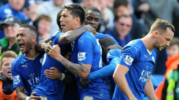 Leicester City's Leonardo Ulloa, centre, celebrates after scoring during a match against West Ham United on April 17. The English Premier League team stands a real chance of winning it all for the first time in the club's 132-year history