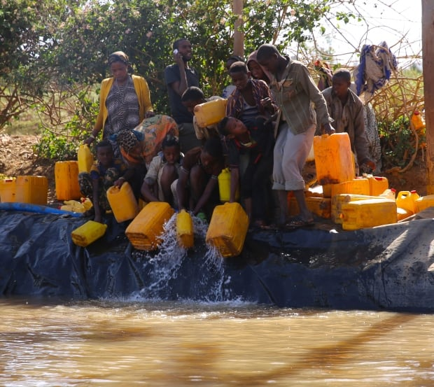 People line up at a water point in eastern Ethiopia