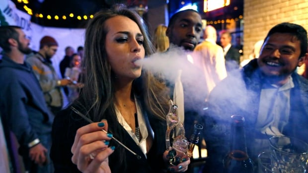Partygoers celebrate in Colorado, where pot became legal in 2012, in this 2013 file photo. As Canada moves toward legalization, etiquette questions about using marijuana at parties and in other social settings will need to be addressed.