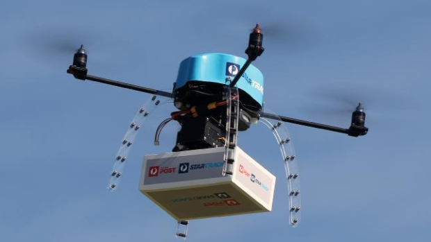 A drone takes a package into the air during a test flight for Australia Post. Canada Post is quietly exploring the possibility of using the small, unmanned aerial vehicles to make deliveries.
