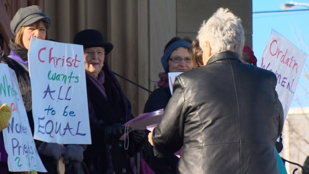 Members of the New Brunswick Catholic Network for Women's Equality recently held a silent protest in front of the Cathedral of the Immaculate Conception of the Diocese of Saint John.