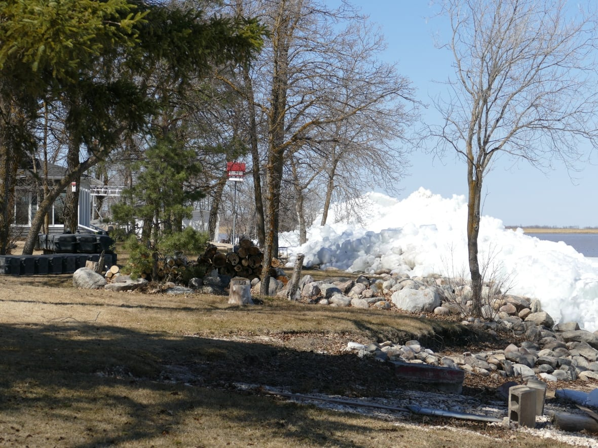 Dauphin Lake residents watch as large piles of ice inch