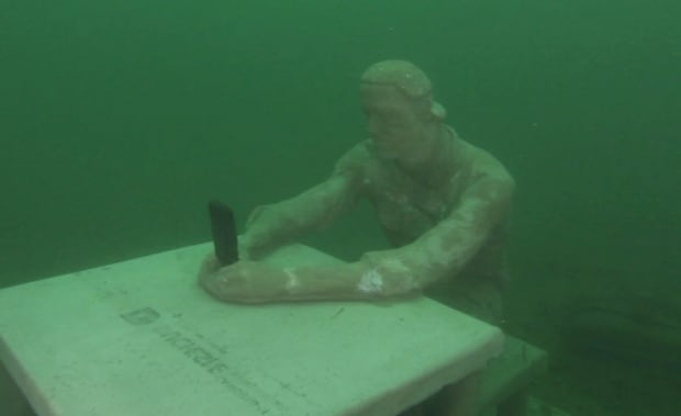 Ontario shipwreck concrete statue underwater St Lawrence