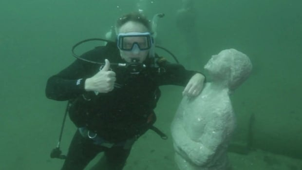 A group of people trying to preserve Ontario's underwater shipwrecks hopes divers will want to hang onto concrete statues of people instead of deteriorating wood.
