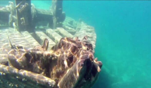 Ontario shipwreck concrete statue underwater St Lawrence April 2016