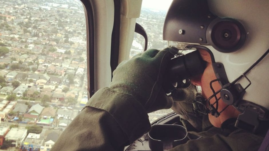A noted architecture writer, Geoff Manaugh, looks at cities and buildings through the eyes of a burglar. In this photo, Manaugh flies over Los Angeles with the LAPD Air Support Division.